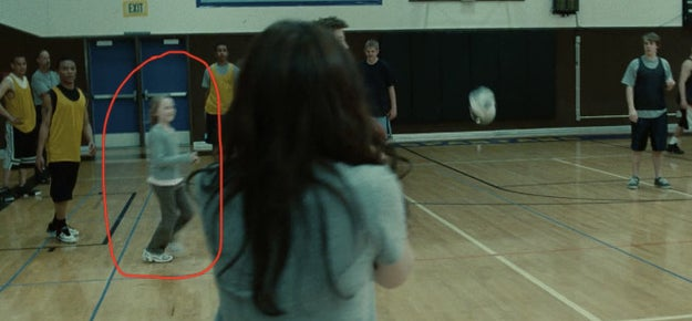 This girl, who does NOT look old enough to be playing a volleyball game during P.E. in a high school.