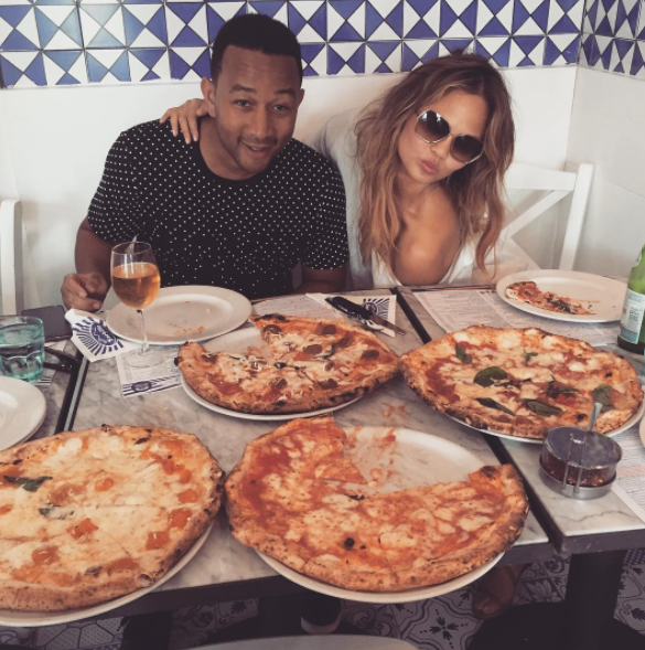 Imagine gobbling down four different types of pizza while Chrissy Teigen puts you on her Snapchat and John Legend provides the tunes.