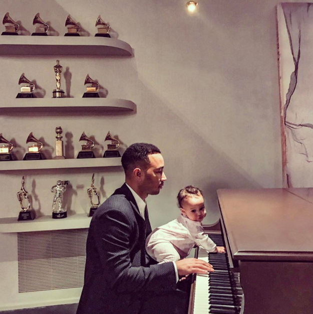 John Legend practiced piano with his daughter.