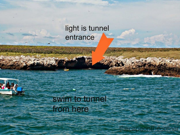 To reach the beach, visitors must swim through a short underwater tunnel.