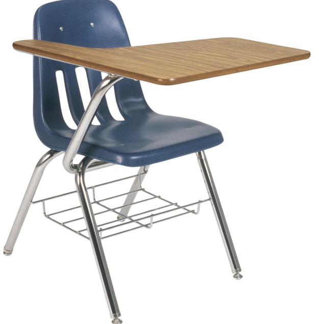 Cramming yourself into one of these desks — that made the LOUDEST screech whenever you moved them.