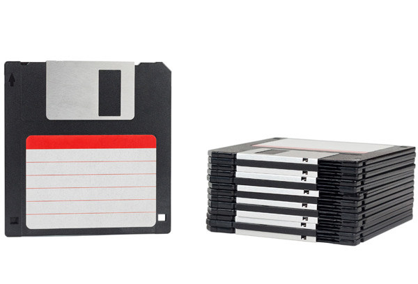 Carrying around important school projects on floppy disks.