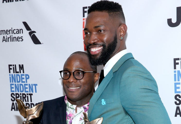Barry Jenkins and Moonlightwriter Tarell Alvin McCraney, wearing the ampersand pin
