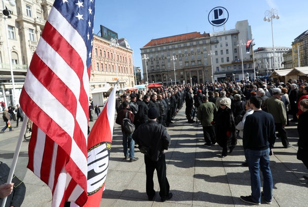 Alongside the US flag, the group also carried both the Croatian flag and the flag of the Nationaldemokratische Partei Deutschland (NDP), a party that German states have tried to ban for its similarity to the actual Nazi Party.