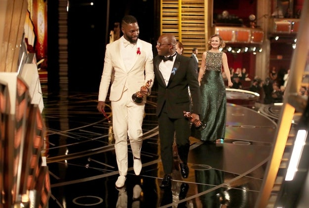 Moonlight screenwriter Tarell Alvin McCraney and writer/director Barry Jenkins after they won Best Adapted Screenplay.