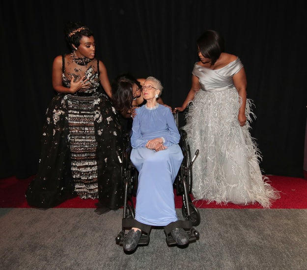 A sweet moment between Janelle Monae, Taraji P. Henson, Octavia Spencer, and NASA mathematician Katherine Johnson, who Henson portrays in Hidden Figures.