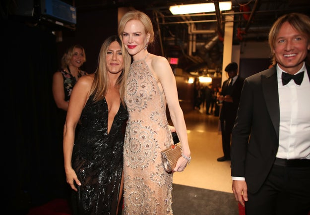 Jennifer Aniston and Nicole Kidman embrace.
