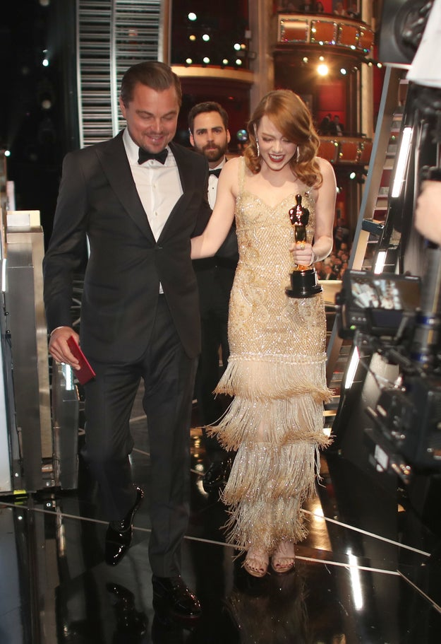 And Leonardo DiCaprio and Emma Stone after he presented her with the Best Actress Oscar.
