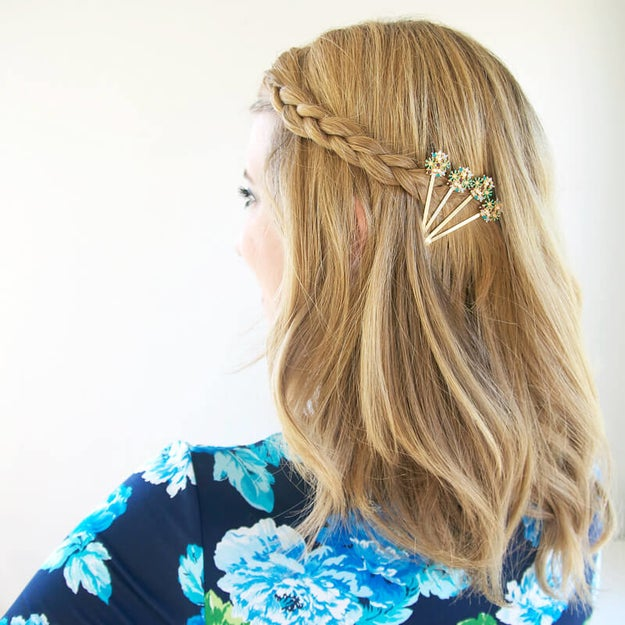 Use a few embellished hair pins to turn a small braid into a statement.