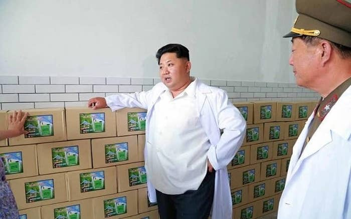 Kim Jong Un inspects packages of biopesticide made at the Pyongyang Bio-technical Institute.