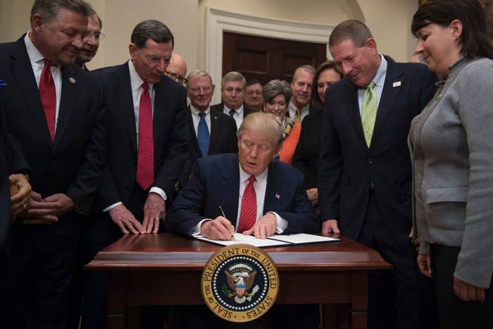President Trump signing the executive order aimed at killing Obama's contentious clean water rule.