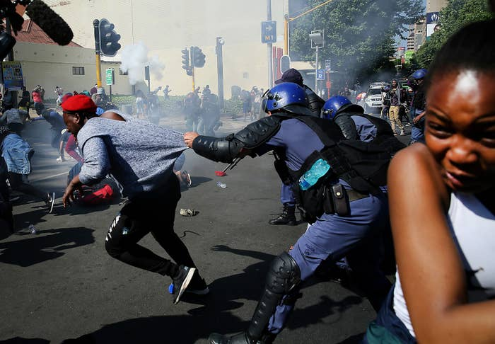 Kgomotso Tjie is grabbed by police at a protest on September 21, 2016.