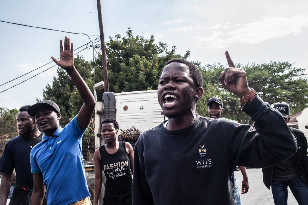 Students protest in front of the police station in Johannesburg, October 2016.