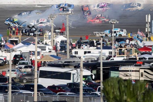 Later on in the race Kevin Harvick got involved in this insane wreck (his car is the one with the 4 on the roof), which may explain why he's always such a debbie downer.