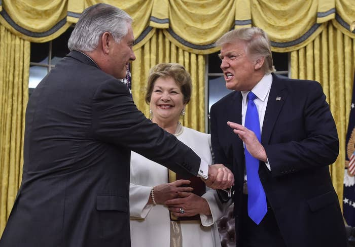 President Trump shakes hands with Rex Tillerson as Tillerson is sworn in as secretary of state on Feb. 1.