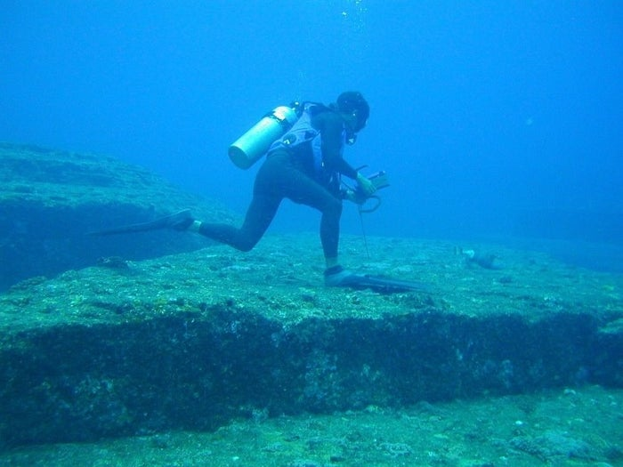 The Yonaguni Monument is a series of pyramidical underwater ruins and ledges off the coast of Japan that some people believe are the remains of an ancient culture. The monument is made up of straight walls, columns, platforms, and a carving of a human-like face, but the Japanese government don't believe that it's some kind of Atlantis-style city probably made by aliens, and refuse to protect it.