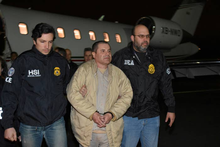"Mexico's top drug lord Joaquin ""El Chapo"" Guzman is escorted as he arrives at Long Island MacArthur airport in New York, U.S., January 19, 2017, after his extradition from Mexico."