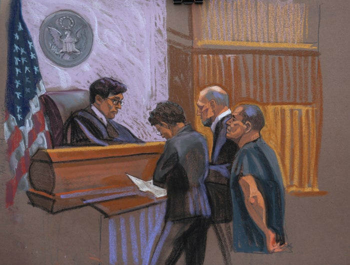 "Joaquin ""El Chapo"" Guzman (r) and defense attorney Michael Schneider (c) and Anne Notopoulos (c, l) are seen in this court sketch in Brooklyn on Jan. 20, 2017."