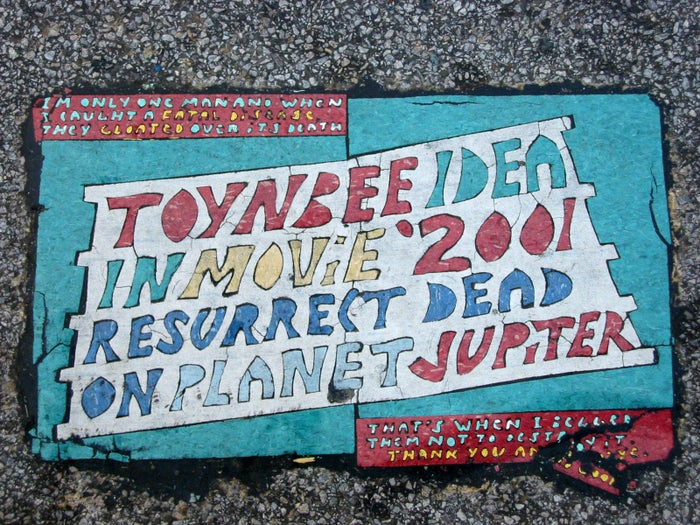 "These baffling, handmade tiles and plaques have been cropping up around the US and South America since the 1980s, and no one knows who is making them, or why. They're the size of a car licence plate, and usually say something like ""In movie 2001 resurrect dead on planet Jupiter"", a reference to the 1970s Stanley Kubrick/Arthur C. Clarke film, although a few feature political statements too."