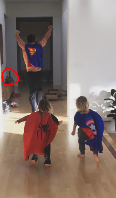 Yes, that is shirtless Thor, dressed as Superman, running around with his twin sons Captain America and Spider-Man. With Mjölnir just chilling in the background.