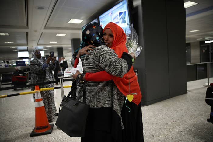 Zahra Warsma, left, hugs her daughter Najma Abdishakur after Abdishakur arrived from Somalia in Washington, DC, on Monday.