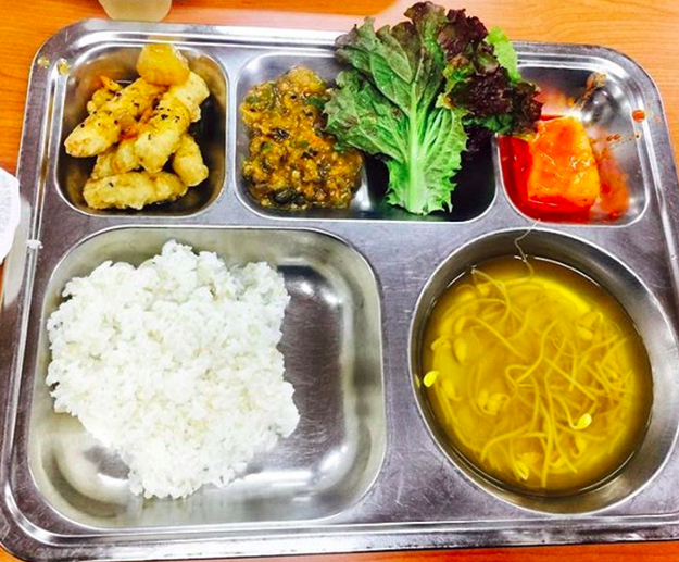 But obviously different countries around the world offer different types of school lunches. For instance, maybe you've waited in a cafeteria line to eat Korean sweet and sour pork.