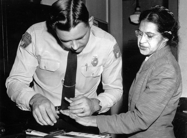 Rosa Parks is fingerprinted by a police officer in Montgomery, Alabama, on Feb. 22, 1956, two months after refusing to give up her seat on a bus for a white passenger on Dec. 1, 1955. She was arrested with several others who violated segregation laws. Parks' refusal to give up her seat led to a boycott of buses in December 1955, a tactic organized by the Rev. Martin Luther King Jr.