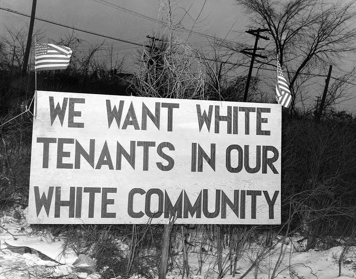 White tenants seeking to prevent black Americans from moving into the Sojourner Truth Homes, a federal governmental housing project, erected this sign in Detroit in 1942.