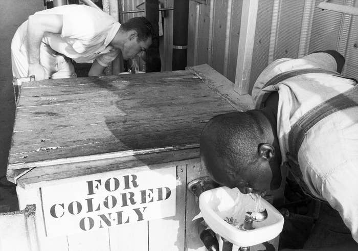 In This Undated Picture Men Drink From Segregated Water Fountains