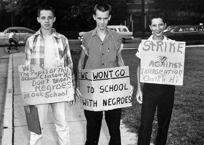 From left: Buddy Trammell, Max Stiles, and Tommy Sanders, students at Clinton High School in Clinton, Tennessee, picket their school when it becomes the first state-supported school to integrate, on Aug. 27, 1956.