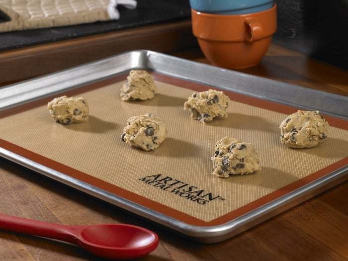 """I spent years spraying pans or prying bits of parchment paper off my cookies. I've never baked anything that didn't pop right off a silicone baking mat. I don't use a sheet pan without one. Good for savory stuff, too!"" —Jason Gillis, FacebookGet this one on Amazon starting at $14. / Available in a variety of sizes."