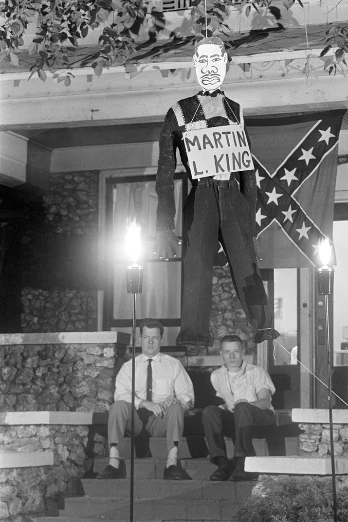 Counter-protesting against civil rights demonstrations, Edward R. Fields and James Murray, members of the National States Rights Party, hang an effigy of Martin Luther King Jr. outside the party's headquarters in Birmingham, Alabama, on May 6, 1963.