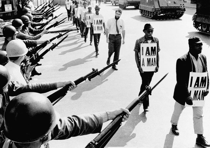 Civil rights activists trying to stage a protest are blocked by National Guardsmen brandishing bayonets on Beale Street in Memphis, Tennessee, 1968.