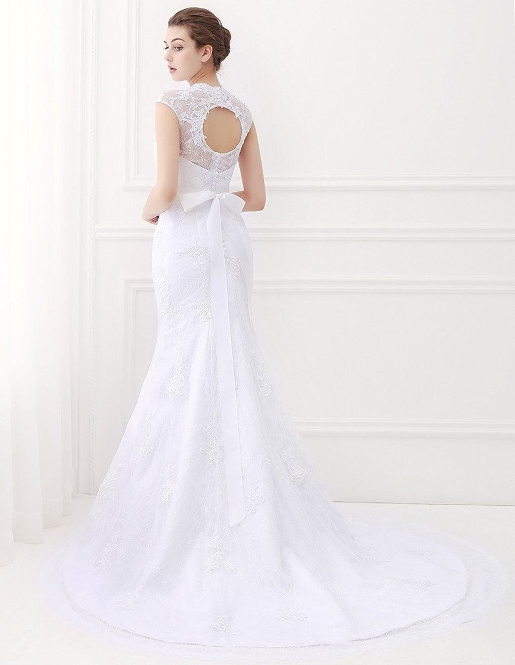 A Bridal Gown With A Bow In The Back, Because Your Undying Love Is The  Greatest Gift Of All. Amirite?