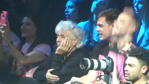 Nonna was passing the time by resting her chin on her hand...