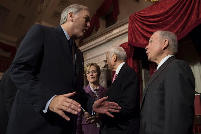 Newly sworn in Senator Luther Strange talks with US Attorney General Jeff Sessions, who he replaced.