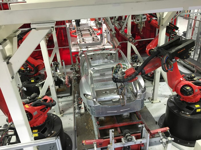 Tesla vehicles are being assembled by robots at Tesla Motors Inc factory in Fremont, California, on July 25, 2016.