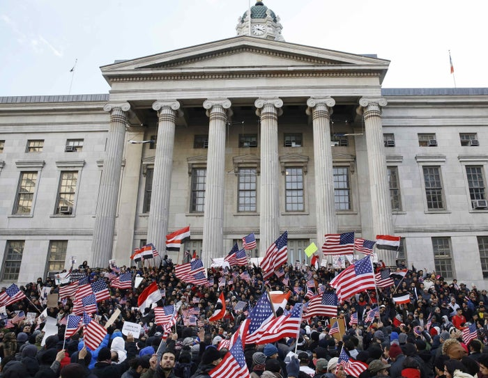 Members of the Yemeni community and others on the steps of Brooklyn's Borough Hall protest President Donald Trump's travel ban.