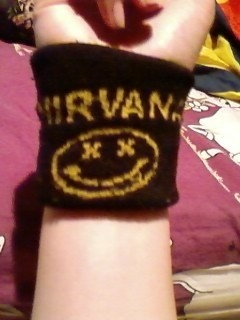 This wristband featuring the logo of your favorite band at that time: