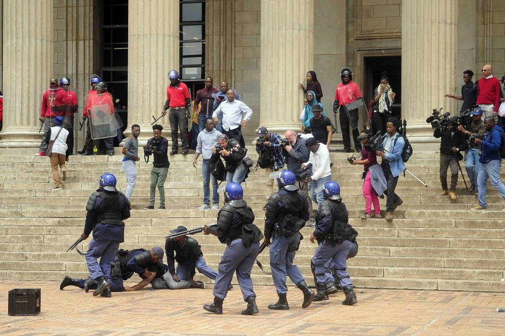 Wits University student leader Mcebo Dlamini is apprehended by police on Oct. 4, 2016.