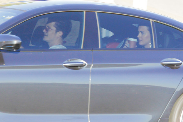 Soon after, Katy was seen riding in the back seat of Orlando's car (like an Uber rider or something???) and it then became clear that it was REALLY on.