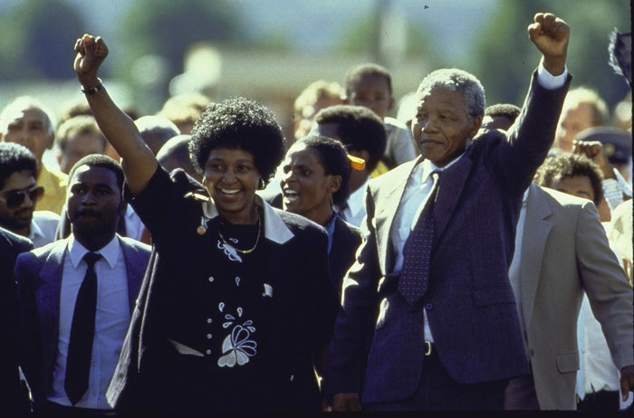 Nelson Mandela and wife Winnie raise their fists upon his release from prison after 27 years.