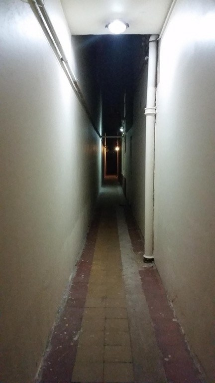Imagine having to walk down this hallway to get where you need to go, the lights getting dimmer and dimmer...