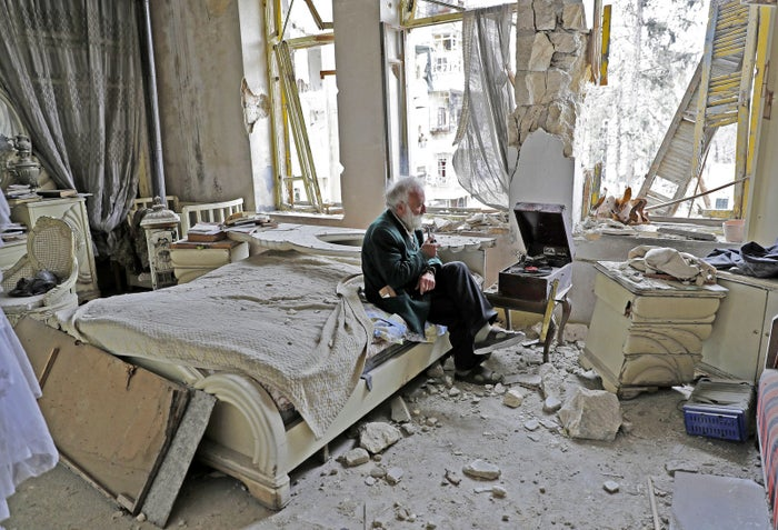"This powerful image of Anis, sitting in the rubble-strewn ruins of his family home, smoking his pipe, and listening to his vinyl records in a city ravaged by years of civil war, was taken by AFP's Joseph Eid. Eid, a Beirut-born photographer, told BuzzFeed News he wanted to track down Anis to see how he was doing several months after his AFP colleague wrote about him during the deadly siege of eastern Aleppo. ""We searched for him in the neighborhood, we asked about him to the residents there and they led us immediately to his house. We knocked the big green steel gate and he opened for us,"" Eid said.The image has been shared thousands of times on social media in the last couple of days. The Washington Post's Ishaan Tharoor posted it on his Twitter account on Monday, and since then his tweet alone has been retweeted 6,000 times.""I knew that it would make a strong picture but never thought that it would go viral as it did,"" Eid told BuzzFeed News."