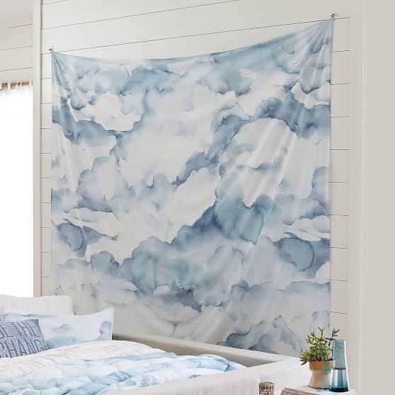 "Sorry, I'm never coming back down. ☁️Get it from PB Teen for $39+ / Available in small (72"" by 48"") and large (106"" x 96"").You can also get a similar cloud tapestry from Urban Outfitters for $69 and matching pillowcases for $49."