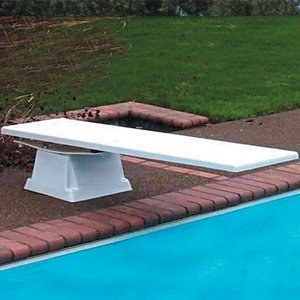 An in-ground pool with a diving board.