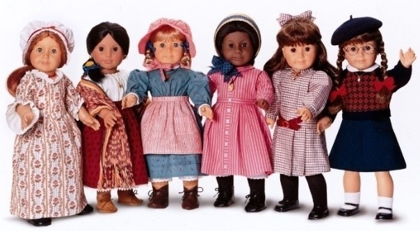 A collection of American Girl dolls.