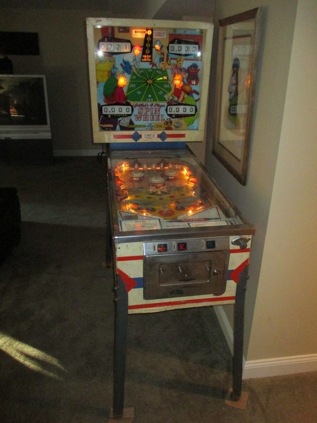 Some kind of pinball machine in their furnished basement.