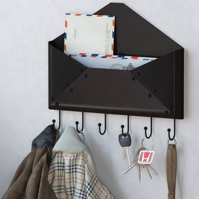 Don't put your keys some place you definitely won't find in the morning. And if you're anything like me, your mail is all over the place so now there's a designated space for it. You're welcome. Get it from Amazon for $13.99.