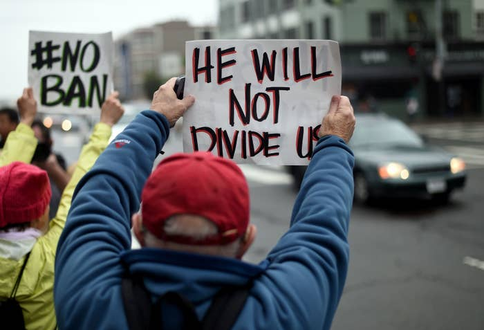 Protesters hold up signs in front of the United States Court of Appeals for the Ninth Circuit in San Francisco, California, on Feb. 7.